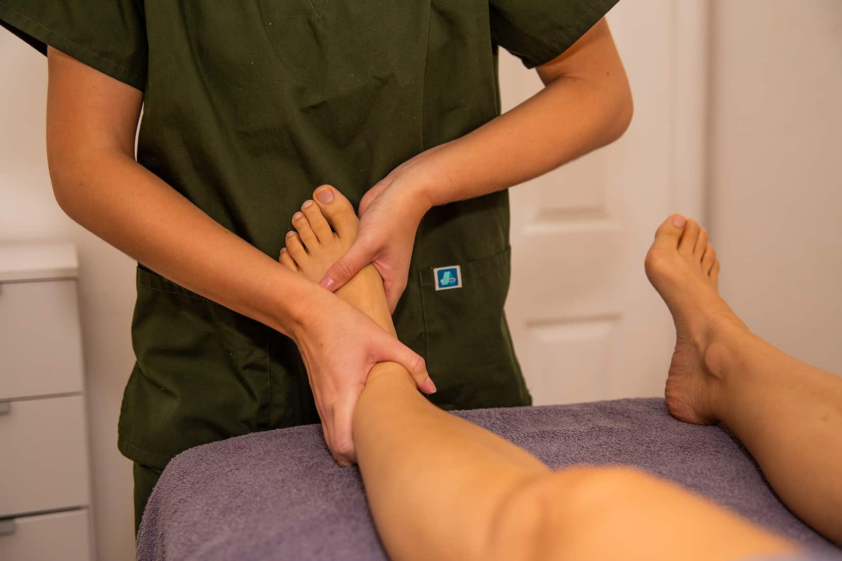 Massage Treating Ankle Pain